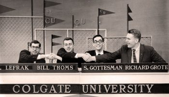 Colgate University Quiz Bowl participants shake hands on set
