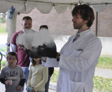 Brendan Mullan '07 does a science demonstration for an audience