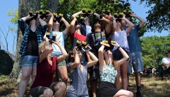 Students use devices to observe the solar eclipse