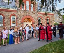President Brian W. Casey and Provost Tracey Hucks '87, MA'90 lead a procession of faculty on the Academic Quad amidst first-year students before convocation