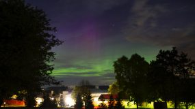 The lights of the Aurora Borealis as seen over the lights of campus