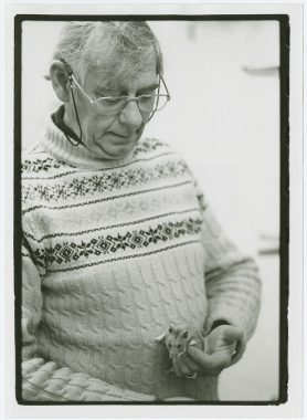 Black and white photo of Roger Alan Hoffman holding a rodent