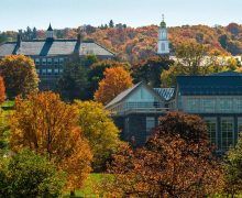 The Colgate University campus from a distance amidst autumn foliage