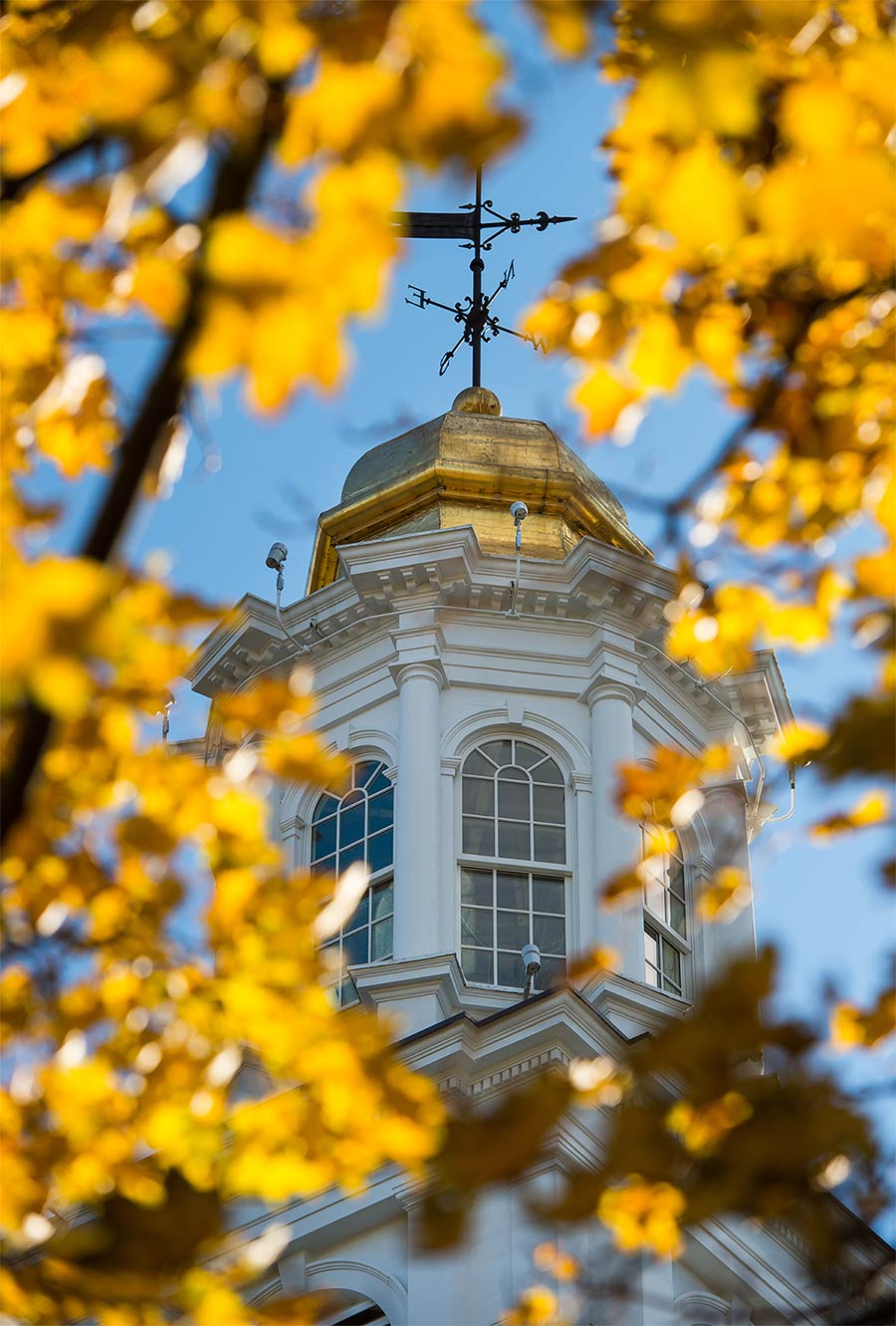 The Colgate Memorial Chapel cupola viewed through the fall foliage