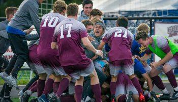 Men's soccer team celebrates on the field