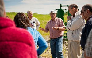Professor Bruce Selleck '71 teaching a group of adult learnings at a natural gas mining station