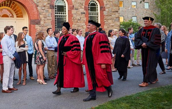 Dean Tracey Hucks walks with president Brian Casey