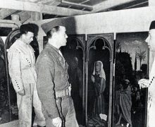 Soldiers inspect works of art