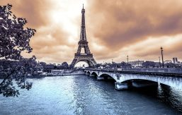 Artistic photo of the Eiffel Tower over the Seine