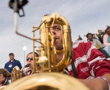 Ryan Rios '20 playing saxophone during football game