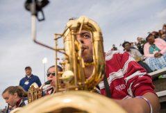 Ryan Rios '20 playing saxophone during football game