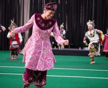 Woman in Native American dress dancing