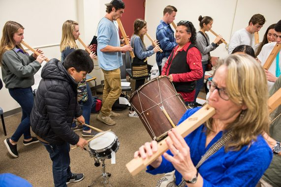 Students and professors practicing with Bolivian instruments