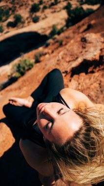 A woman meditating in canyon