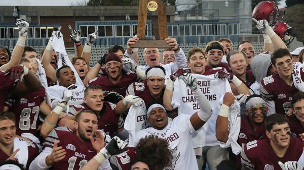 Colgate football team celebrating with Patriot League trophy