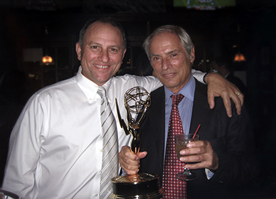 C Fager and Bob Simon celebrating an Emmy win.
