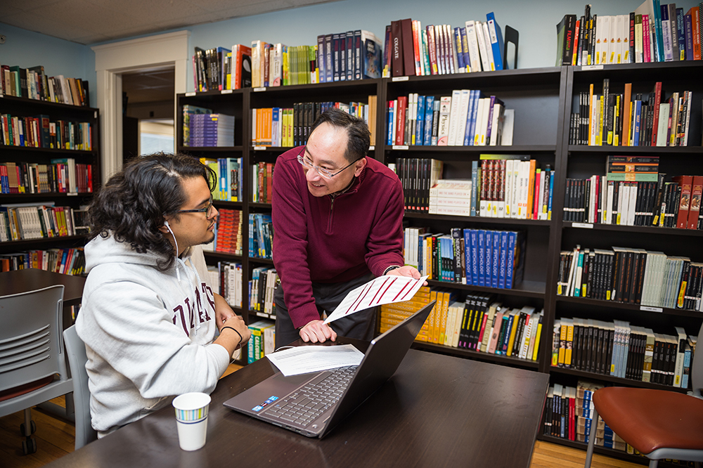 Jason Dominguez '20 and Frank Kuan in the OUS library