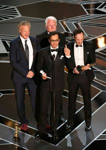 David Fialkow '81 and colleagues accepting Academy Award