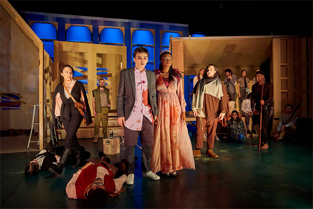 "Students on stage, covered in stage blood, performing ""Romeo and Juliet and Zombies"""