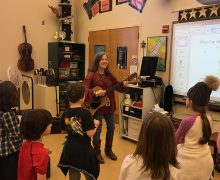 Suzanne Propp '85 with an elementary school music class