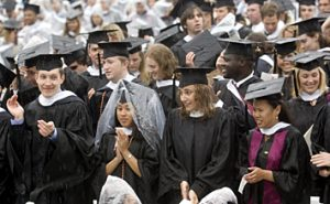 Members of the Class of 2006 applaud during Sunday's chilly and wet commencement.