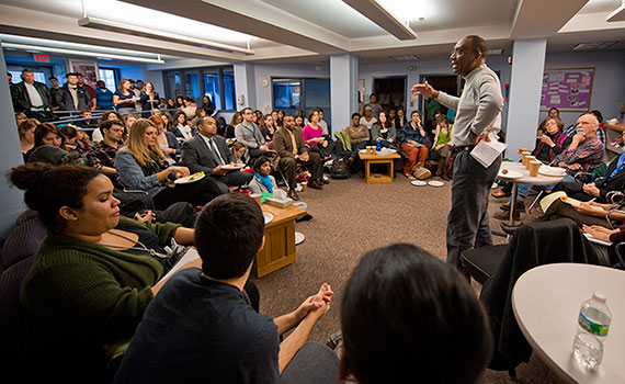 Students, faculty, and staff fill the Center for Women's Studies to hear Professor Brian Moore present at last year's MLK Week