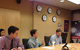 Jimmy DeCicco '15 (left) with Troy Somero '06 (center) at an ESPN sales meeting.