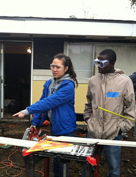 Students in New Orleans help repair a home damaged in Hurricane Isaac