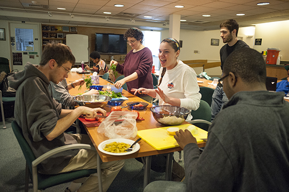 Students participating in an interfaith trip to Turkey learn about the country's culture and how to cook Turkish food at the chapel.