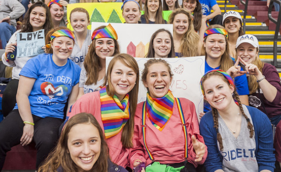 During Colgate's Blue for Q men's basketball game, Delta Delta Delta sisters were just one group of students who showed their support for lesbian, gay, bisexual, transgender, and queer initiatives on campus.