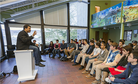 Neil deGrasse Tyson speaks with students at the ALANA Cultural Center as part of his visit to Colgate University.