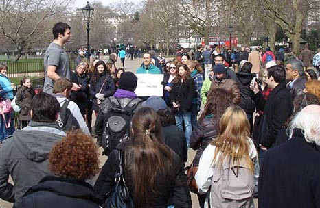 [Get name] on London Study Group addresses a crowd at Hyde Park's Speakers Corner.
