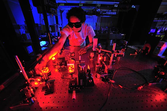 A student works with laser experiments in Prof. Kiko Galvez's physics lab in Colgate's Robert H.N. Ho Science Center. (photo 2008)