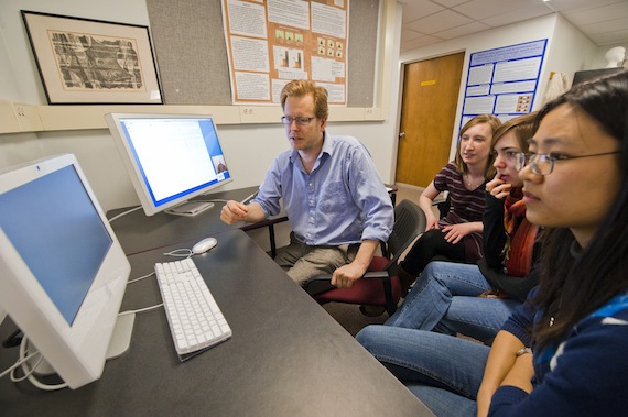 In psychology professor Spencer Kelly's cognitive neuroscience lab, students examine data results from experiments to see how the brain responds to gestures. Professor Kelly is on the far left in the blue shirt.
