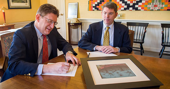 Colgate President Jeffrey Herbst (left) and Provost and Dean of the Faculty Douglas Hicks sign the agreement with Curtin University of Western Australia.