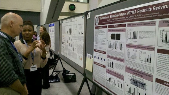 Colgate University student Amanda Anafu '14 explaining her research