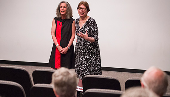 Professors Jennifer Brice (left) and Jane Pinchin discuss Colgate Reads during a recent event on campus. (Photo by Andy Daddio)