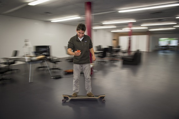 Harry Raymond, founder of an on-line app to explore beers, wines and spirits, skateboards through the Colgate University Thought Into Action Incubator, located on Utica Street in downtown Hamilton, NY.
