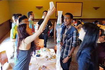 Some International Student Orientation participants take a break from scheduled programming to do a little creative engineering.