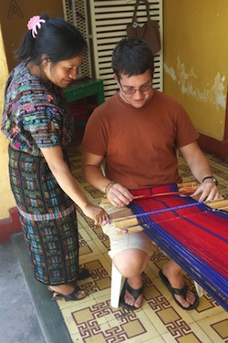 Viktor learning to weave on the backstrap loom