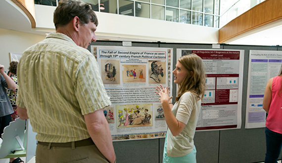 Caitlin Sackrison '15 used the university archives for her research of  19th-century French political cartoons. (Photo by Andy Daddio)