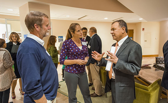 U.S. Rep. Richard Hanna (right) talks with Professors Krista Ingram (center) and Randy Fuller (left) Monday.