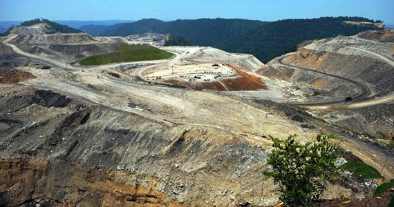 Mountaintop removal practices were used on this mountain in West Virginia. The mountain had been covered with trees like those in the background.