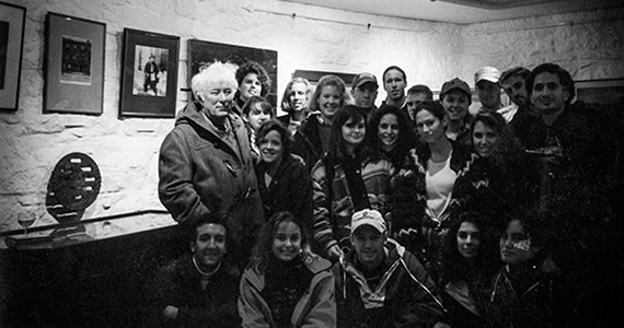 Seamus Heaney stands with Colgate students and Professor Peter Balakian (far right) in Martello Tower in Dublin in 1993.