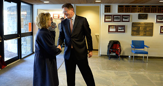 Colgate President Jeffrey Herbst greets Hillary Rodham Clinton just before her address at Sanford Field House. (Photo by Andy Daddio)