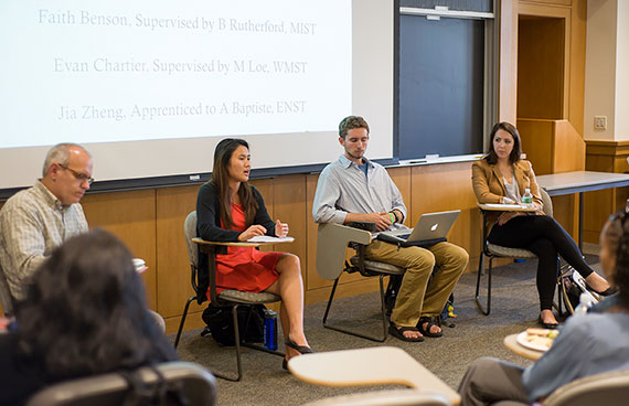 Jia Zheng '14 (second from left) discusses her research at a recent Division of University Studies event. With her are  Evan Chartier '14 and Faith Benson.