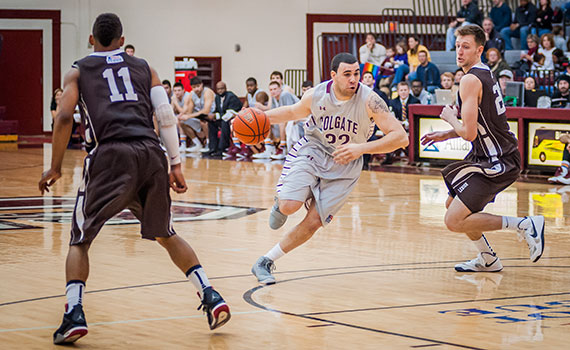 Men's basketball player drives past Lehigh at Coterell Court