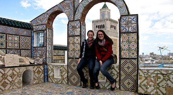 Sarah Dickson '14 (left) spent a semester in Tunisia that has led to two academic research projects.