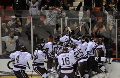 The Raiders celebrate Tyson Spink's winning goal in double overtime. (Photo by Bob Cornell)
