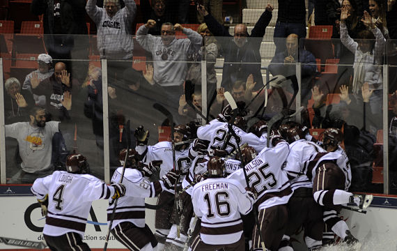 The Raiders  celebrate Tyson Spink's game-winning goal Friday night. (Photo by Bob Cornell)